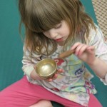 child with singing bowl